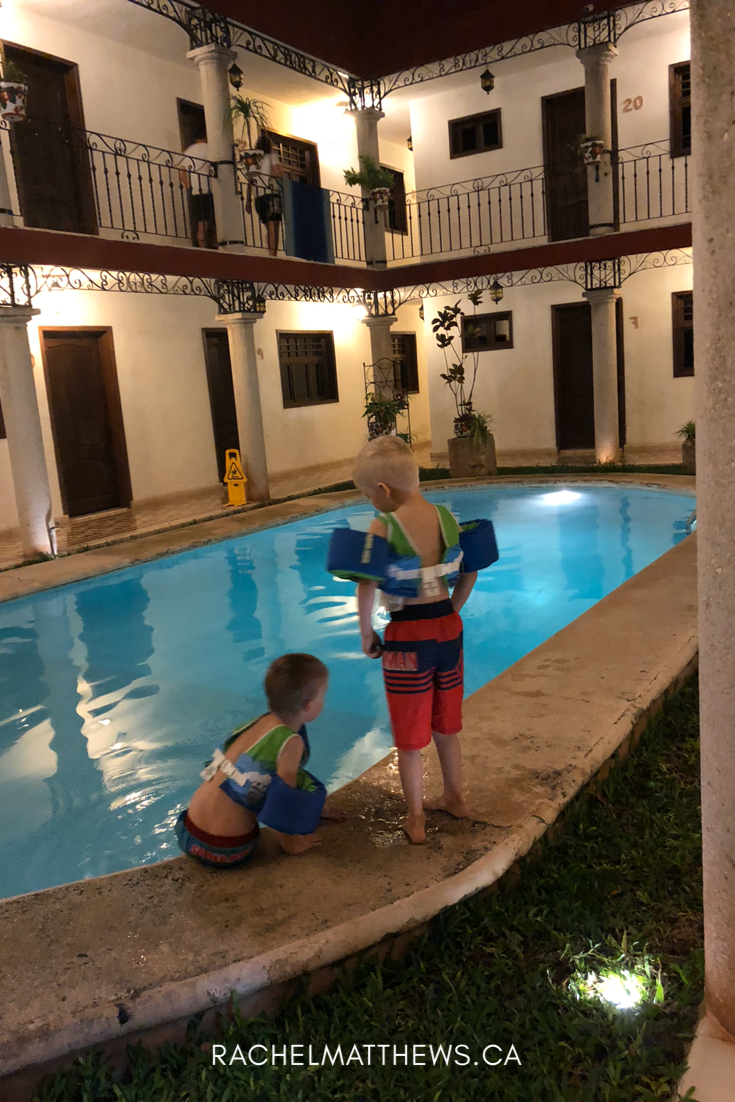 My kiddos taking an after supper swim in the courtyard pool at La Aurora Hotel Colonial in Valladolid, Mexico